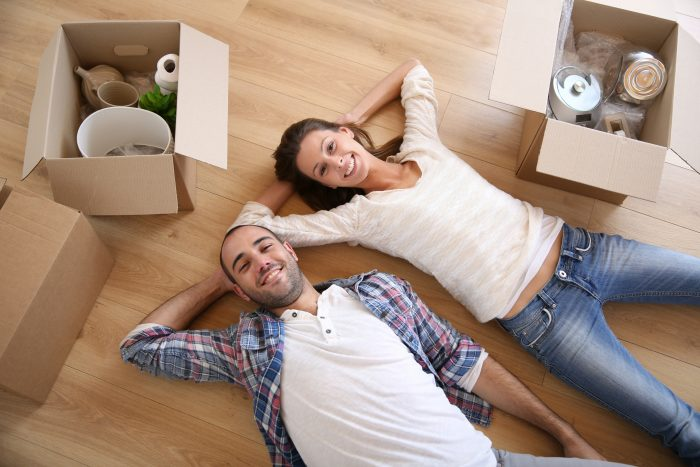 Couple Laying on Floor After Packing Boxes